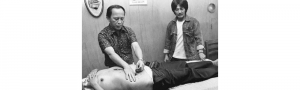 Famous psychic surgeon Antonio (Tony) Agpaoa operating on a patient.