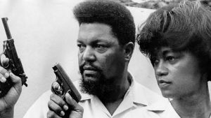 Two people holding guns